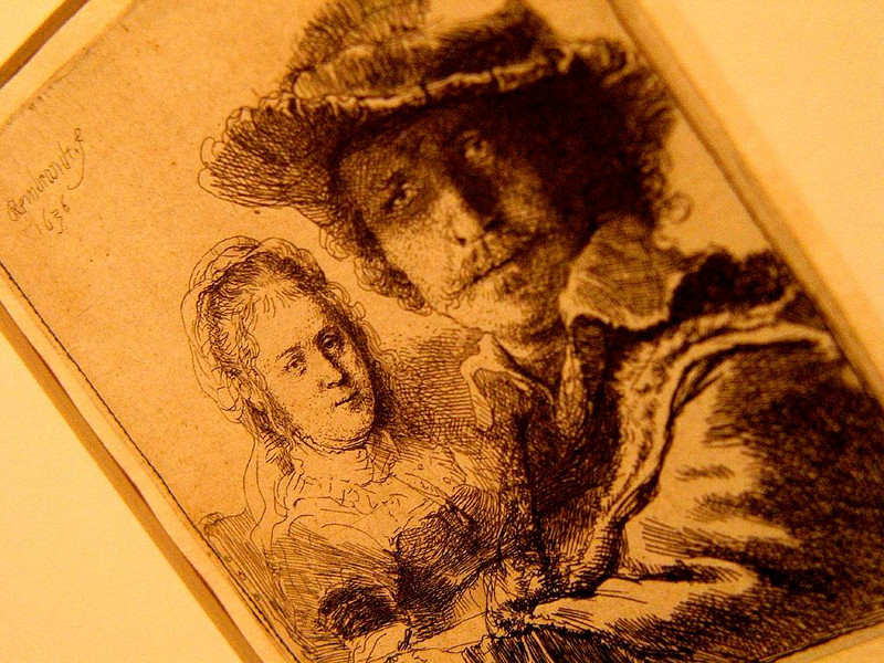 Rembrandt with Saskia, 1636 - Rembrandt's House contains a fine collection of his original etchings and drawings, including various self-portraits in different moods. In this one, 30-year-old Rembrandt includes his first wife Saskia in the background. In photographing it, I placed Rembrandt in soft focus to emphasize the presence of his wife. Saskia died in this house in 1642, only seven years after this portrait was made.