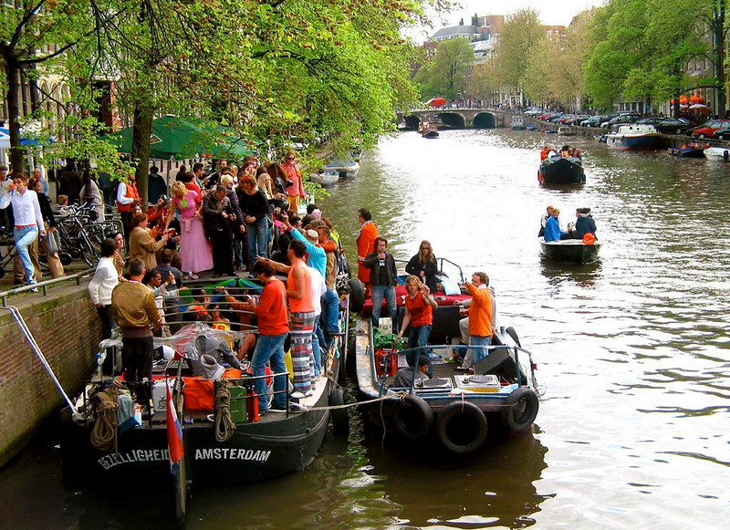 Neighborhood party, Queens Day - Street parties are boat parties in Amsterdam on Queens Day.