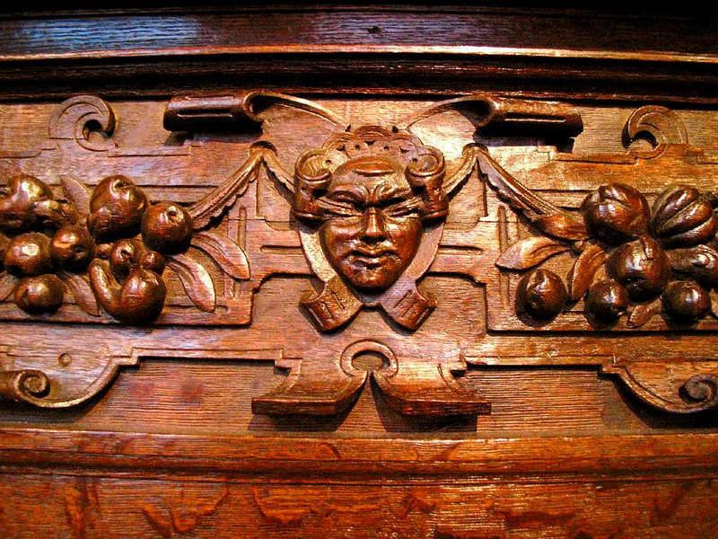Blindfolded in Rembrandt's house? - The face on this richly carved mantlepiece, which stands today in the kitchen of the house in which Rembrandt once lived and worked, appears to be blindfolded. It seems an ironic presence in a house that produced the ultiimate in creative vision.