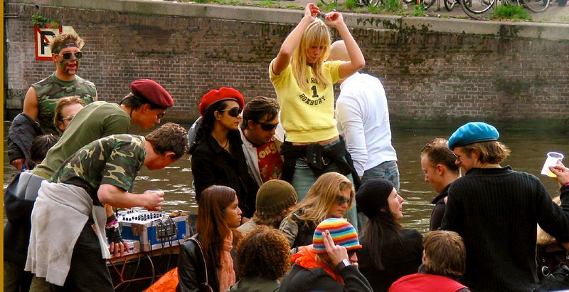 More Queens Day pleasures - Beer flows and dancers gyrate, as Queens Day parties flow through the canals of Amsterdam.