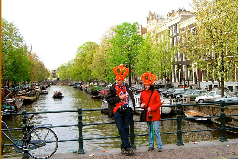 Taking a break - A canal bridge offers a moment of quiet to Queens Day celebrants.