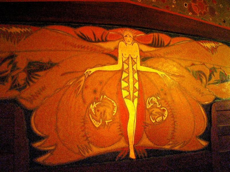 Mural, Tuschinski Theatre - This delightful Art Deco mural can be seen by Amsterdam moviegoers as they leave the Tuschinski Theatre's 1,472 seat main auditorium. Now a six screen movie house, the theatre has been beautifully restored and maintained. Marlene Dietrich and Judy Garland once performed here.