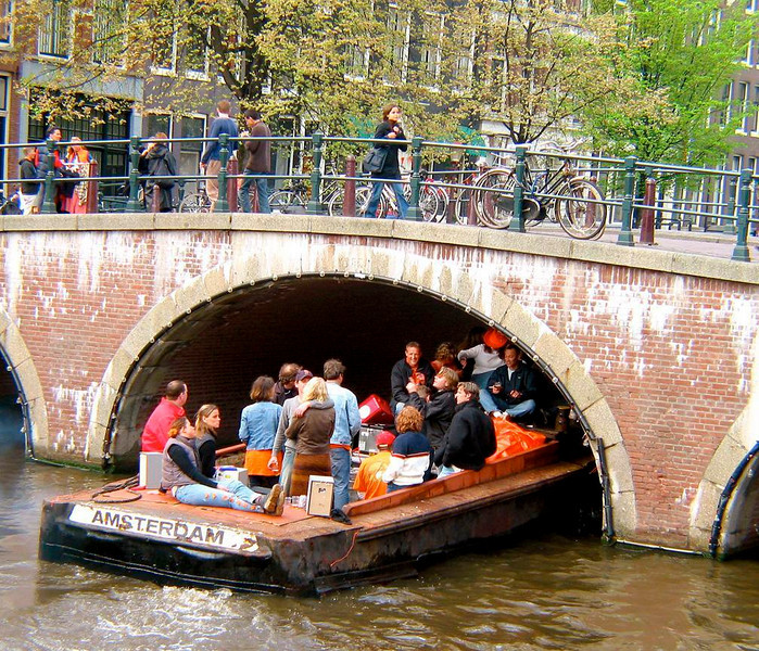 Floating party - Hundreds celebrate Queens Day by partying on the waters of Amsterdam's canals.