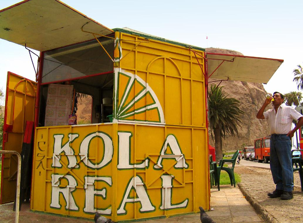 Kola Real Time, Arica, Chile - The day after Christmas was a warm summer day in Arica, and this fellow beats the heat with a quick Kola break.