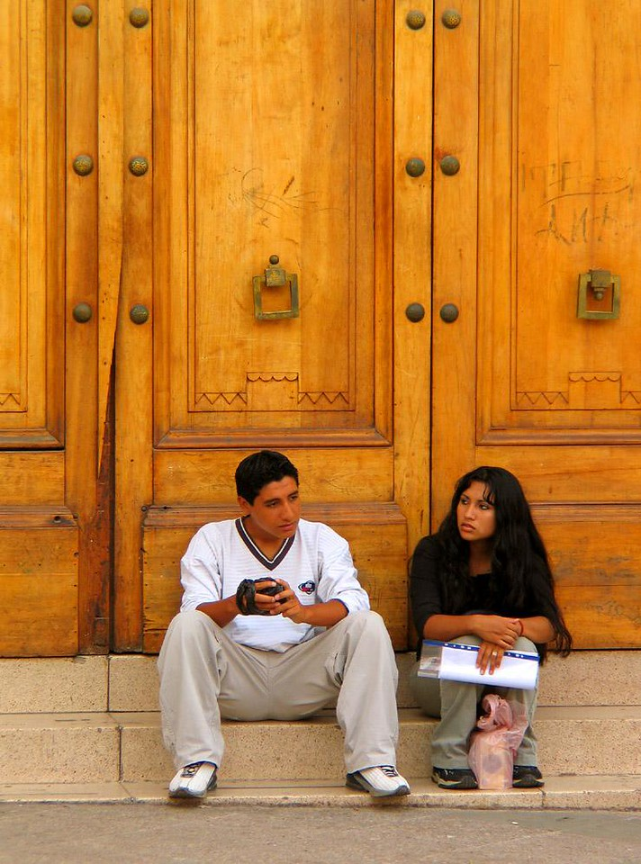 Young Chileans, Arica, Chile - Two youthful Aricans waiting for a local bank to open.