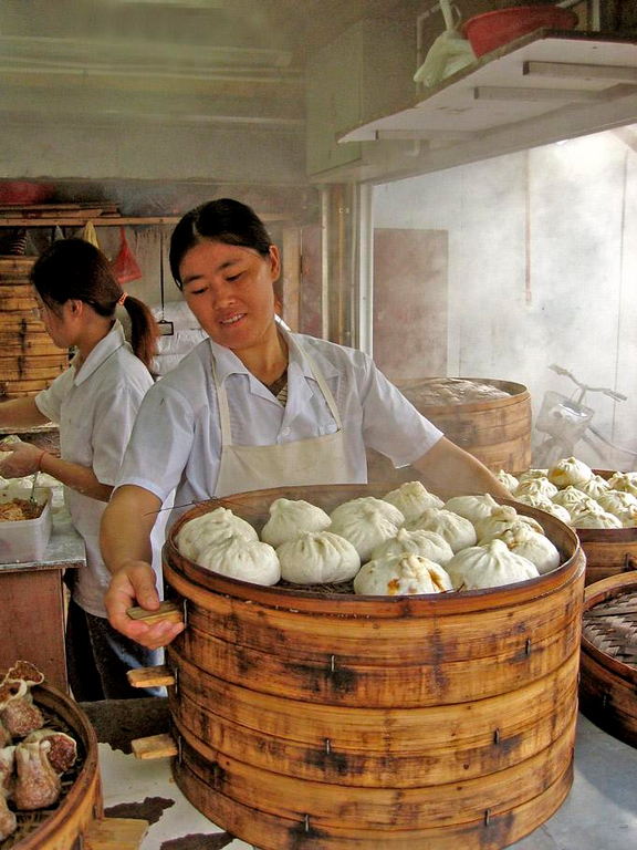 For Shanghai appetites - Huge tubs of steamed breakfast buns are made ready for Shanghai commuters who grab a bite as they dash through People's Park.
