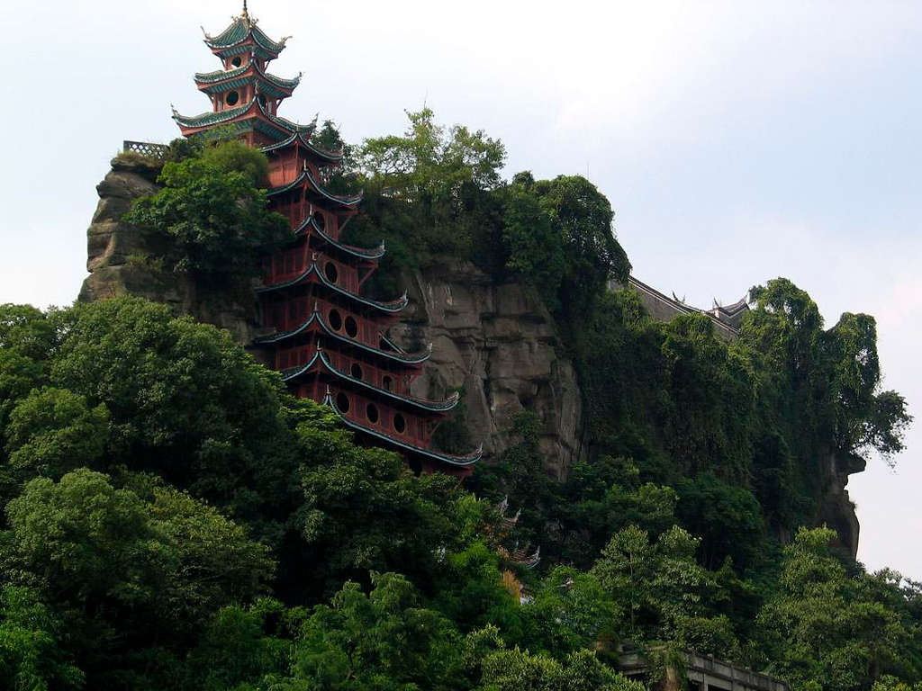 Shi Boa Zhai Pagoda - One of the gems of Chinese architecture is this eight story Pagoda, clinging to a wooded rock near Shi Boa Zhai along the Yangtze River. The rising waters of the river will eventually make an island of this 350 year old structure.
