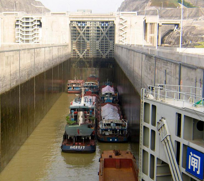 Yangtze locks - One of the twin five-stage locks before the Three Gorges Dam. It can hold seagoing ships as well as this cluster of smaller ships.