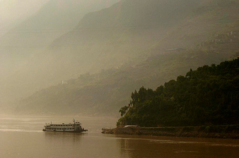 The Old Yangtze Ferry - There are several new bridges now linking opposite sides of the Yangtze, as well as this old Ferryboat. This lovely scene will soon be replaced by a vast reservoir, part of the Three Gorges Dam Project.