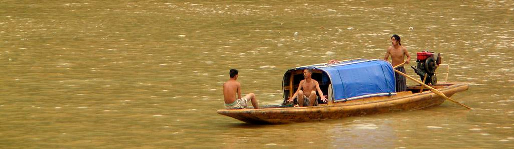 Heated discussion on the river - A sampan passed our cruise boat at a distance, and I was able to photograph this animated discussion from a considerable distance.