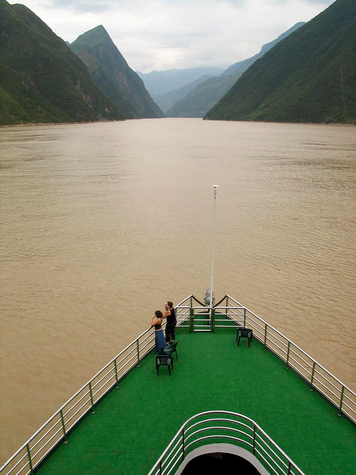Victoria Star on the Yangtze - Our ship, the Victoria Star, carried 100 passengers on the Yangtze transit. Two of them ponder the eventual fate of the Third Gorge from its bow.