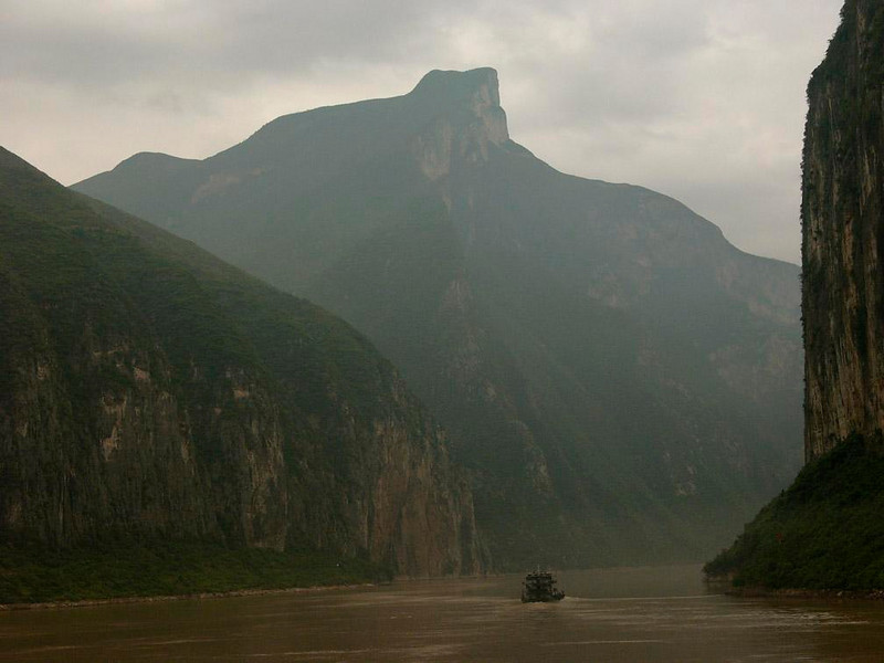 The Deepest Gorge - A jagged mountain peak soars over the Qutang Gorge, its wooded flanks dropping directly into the rising waters of the Yangtze.