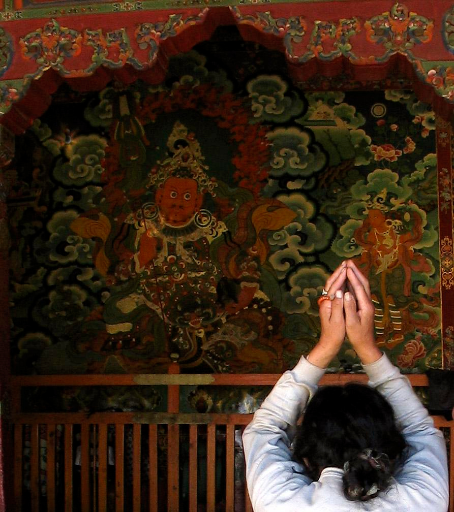 Spiritual expression, Jokhang Temple - Ancient murals draw Buddhist worshippers to the walls of Lhasa's Jokhang Temple.