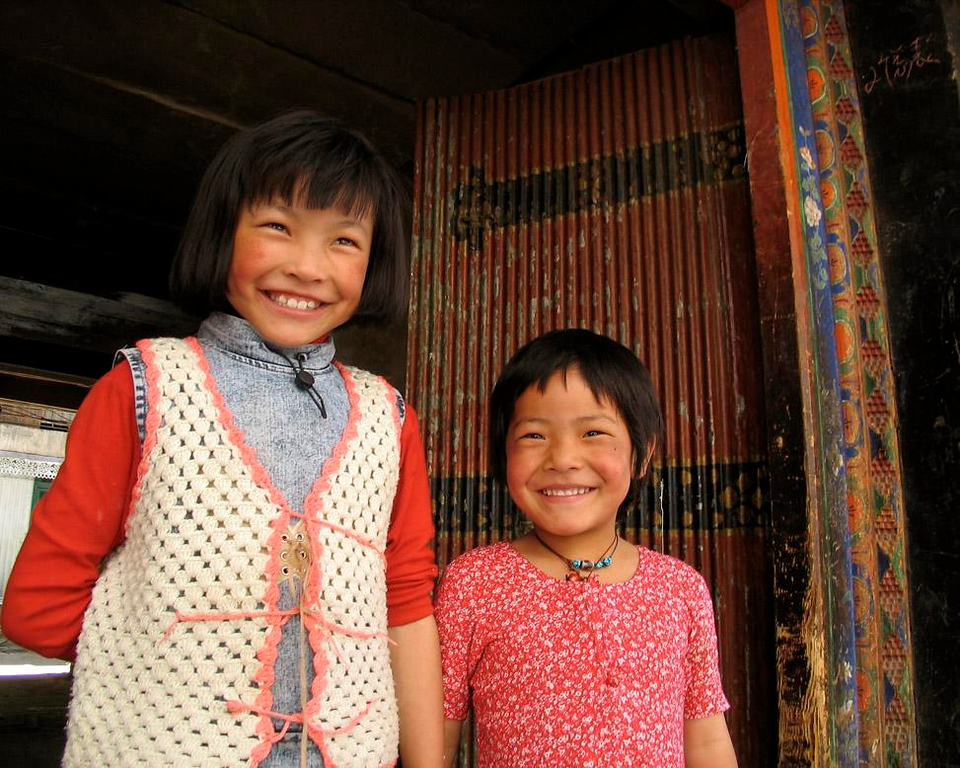 Sisters, Lhasa - Although these young sisters did not not speak English, they took much pride in posing for my camera. When I showed them this image on my digital camera's viewing screen, they both squealed in delight. I could still hear them giggling long after I left the scene.