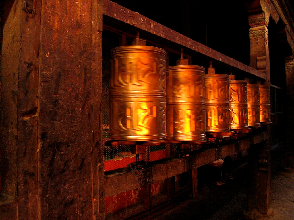 Spinning prayer wheels, Jokhang - The streets adjacent to the Jokhang Temple are lined with prayer wheels -- these still spin from the touch of Buddhist pilgrims.