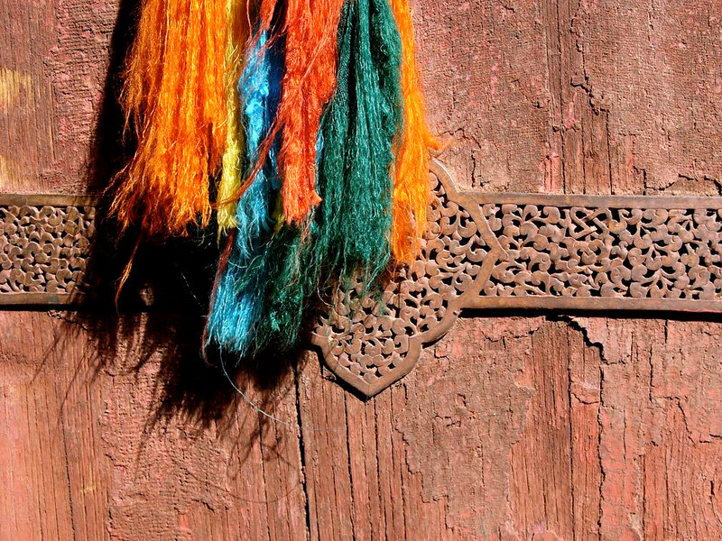 Potala Door, Lasha - The ancient doors of the Potala are decorated with brilliantly colored tassels.