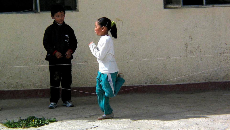 Schoolyard game, Lhasa - Students jump strings instead of rope at the Lhasa boarding school for children with special needs.