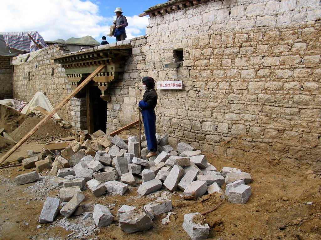 Stone breaker, Lhasa - Breaking stone is not a easy task, and here in Lhasa its a woman's job.