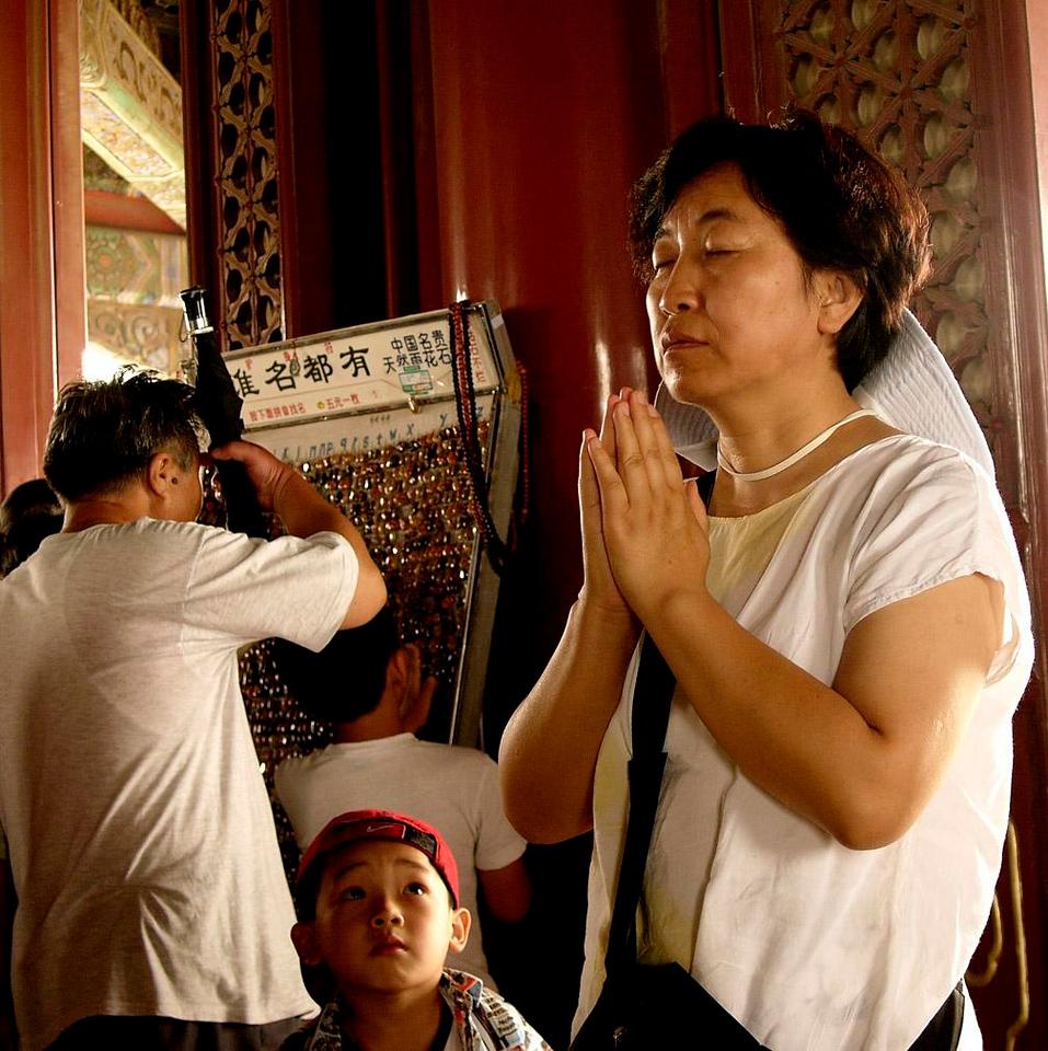 At Prayer, Jinshang Temple - The faithful gather for prayer atop Coal Hill in Beijing's Jinshang Park.