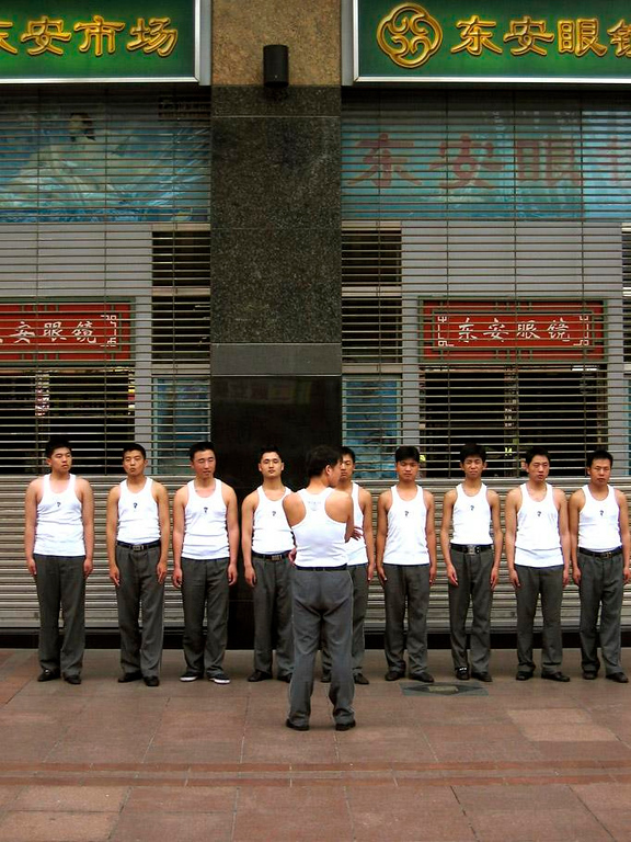 Morning excercise, Beijing - Local security guards participate in exercise drills before going to work.