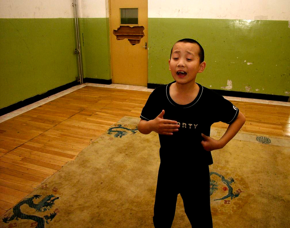 Opera Student, Beijing - A young performer takes his bows in a Beijing Opera School practice session.