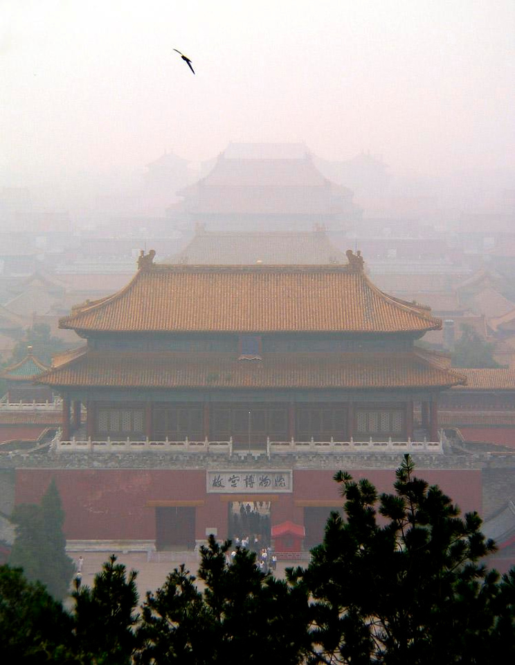 Forbidden City Fogbound - Seen from the top of Coal Hill, the gates of the wonderfully preserved Forbidden City recede into the fog of history. From behind behind these walls, 24 Chinese emperors ruled China from 1421 to 1911.