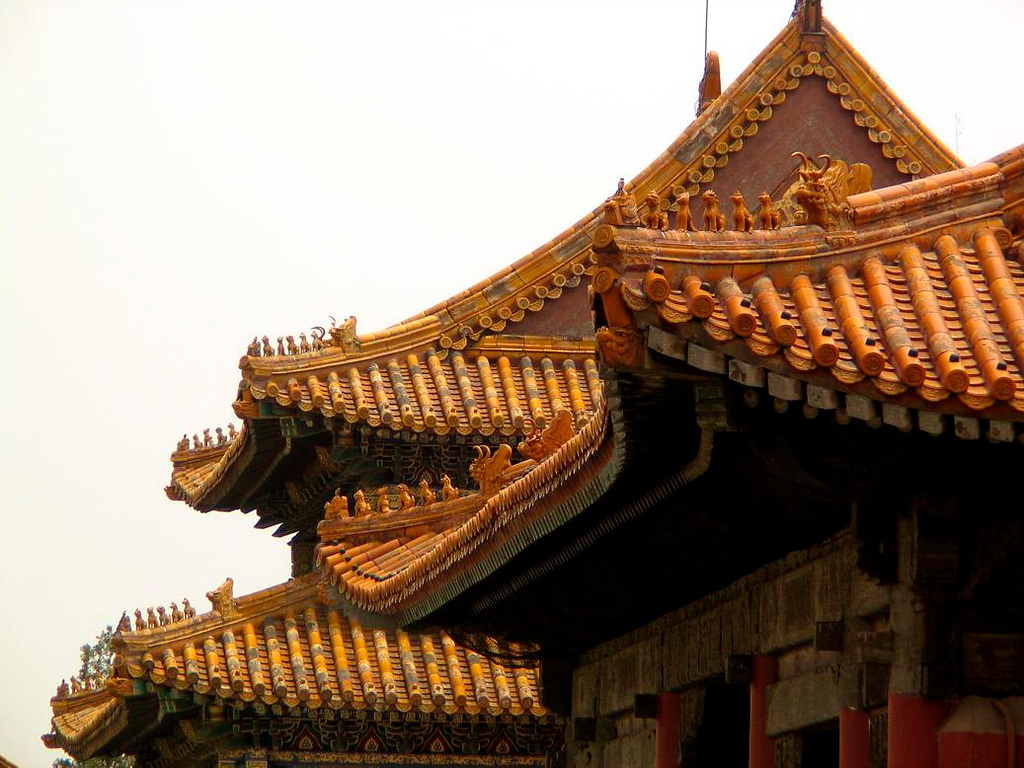 Yellow roofs, Forbidden City - The roofs of the palaces within the Forbidden City are covered in distinctive reddish yellow tiles and guarded by rows of animals intended to ward off lightening strikes.