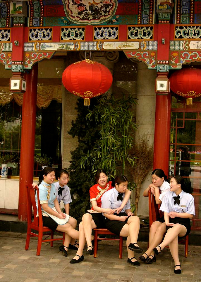 Restaurant Staff, Beijing - Six staffers share three chairs prior to starting their day in a Beijing restaurant.