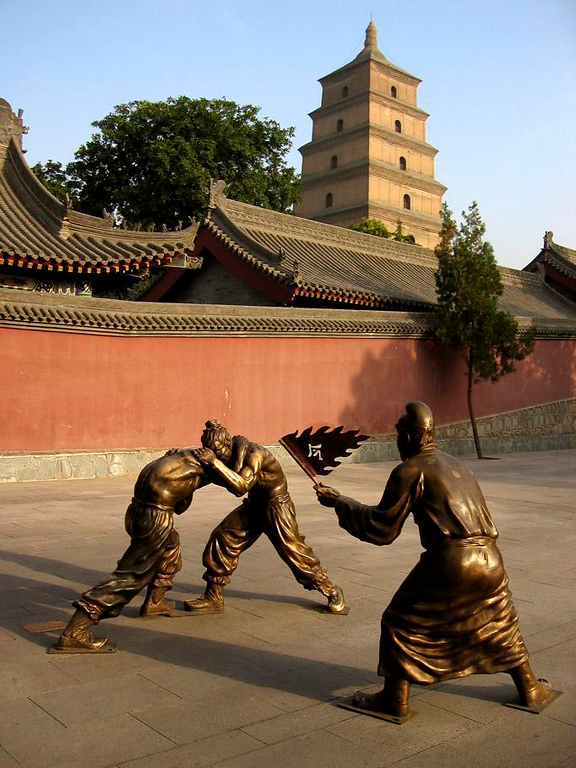 Xian -- core of Chinese civilization - The Tang Dynasty comes alive in the shadow of Xian's Great Wild Goose Pagoda as life-like bronze wrestlers square off at the drop of a flag. The Pagoda dates from 652, and is part of a restored Buddhist Temple complex.