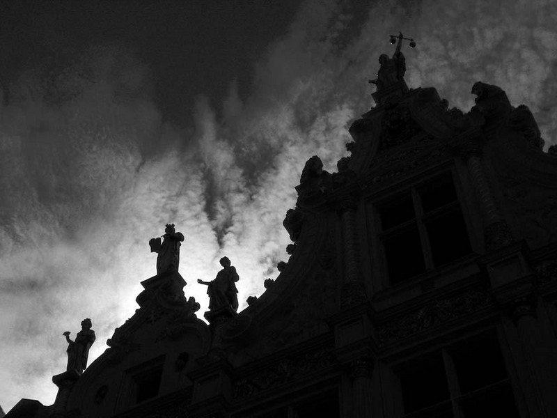 Day into night - One of the oldest and finest town halls in Belgium, Bruge's Stadhuis was built between 1326 and 1420. In this image I made the clouds that boil behind the building the featured performer.