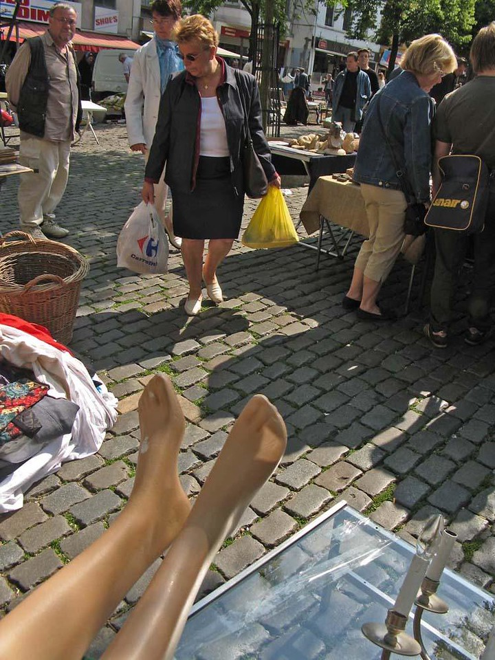 Legs, Place du Jeu de Balle - A flea market has been held on this site since 1640. On the day we were there, this very relaxed mannequin attracted little interest.