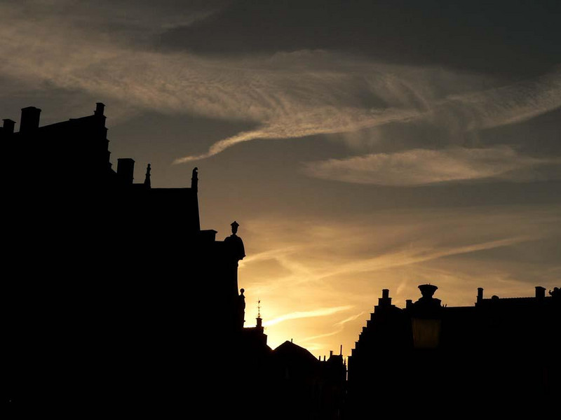 Sunset on the Markt - The Markt, Bruges' Market Square, is lined with buildings as old as 700 or 800 years. I abstract them here at sunset, under clouds that evoke the ghosts of this remarkably preserved medieval city.