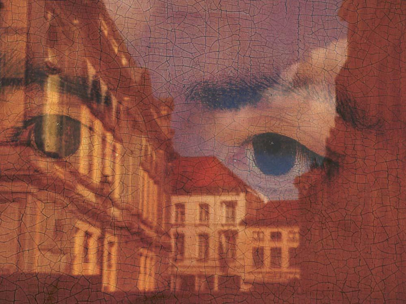 The Eyes of Memling are upon us - Past and present come together as Bruges' opera house is reflected on a glass covered poster featuring the gaze of medieval artist Hans Memling.