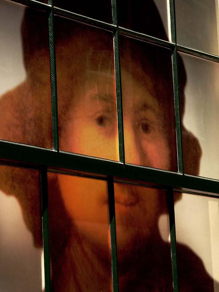 Rembrandt, Leiden - Leiden, the site of the oldest and most prestigious university in the Netherlands, is also Rembrandt's home town. He born here in 1606. I found him gazing at me from behind this window.