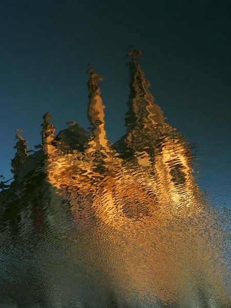 Ghent in reflection - The golden medieval buildings of Ghent explode in reflection upon the waters of the River Leie.