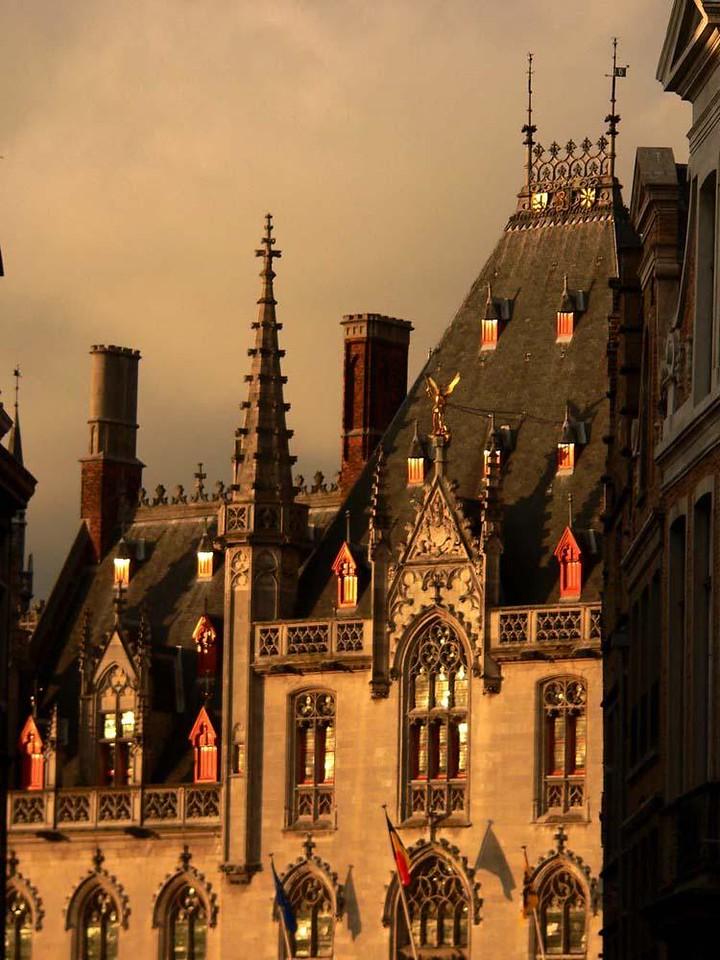 Bruges Dusk - A setting sun splashes the buildings that line Bruges' famed 13th Century Market Place.