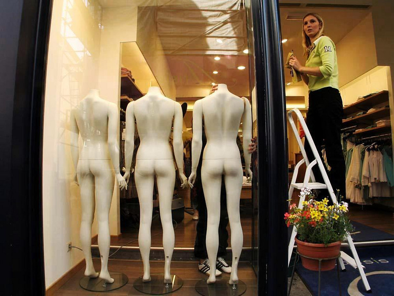 Triple Take: window dressers at work - We were delighted to find this surprisingly incongruous juxtaposition of mannequins and window dressers in a Ghent storefront. The workers seem just as surprised to find themselves the subject of this picture.