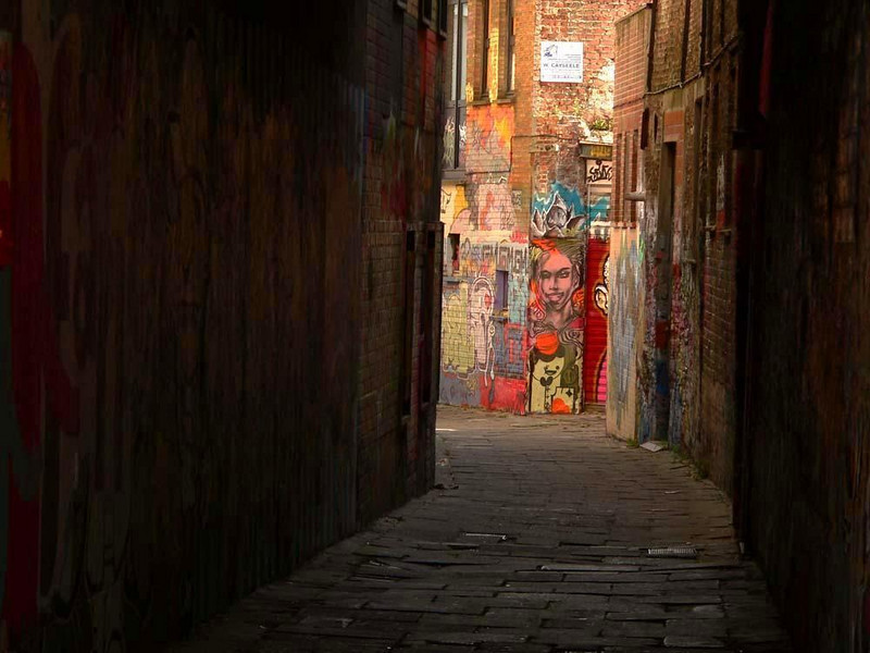 In the alleys of Ghent - Ghent's narrow medieval streets suddenly are warmed by the colors of vivid 21st century grafitti.