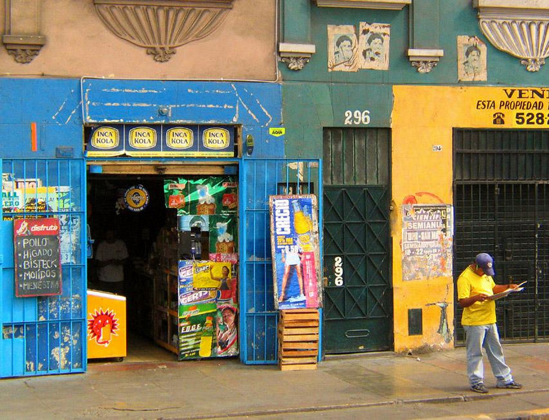 Street Scene, Lima, Peru - The primary colors of yellow and blue are very popular in Peru. I made this photo from the window of a bus as it carried us through the city's neighborhoods.