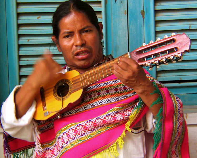 Musician, Montecristi, Ecuado - Entertainers enliven things in Montecristi's market.