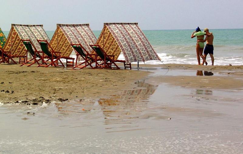 Beachwalkers, Manta, Ecuador - Manta's beaches stretch for miles along the blue Pacific.