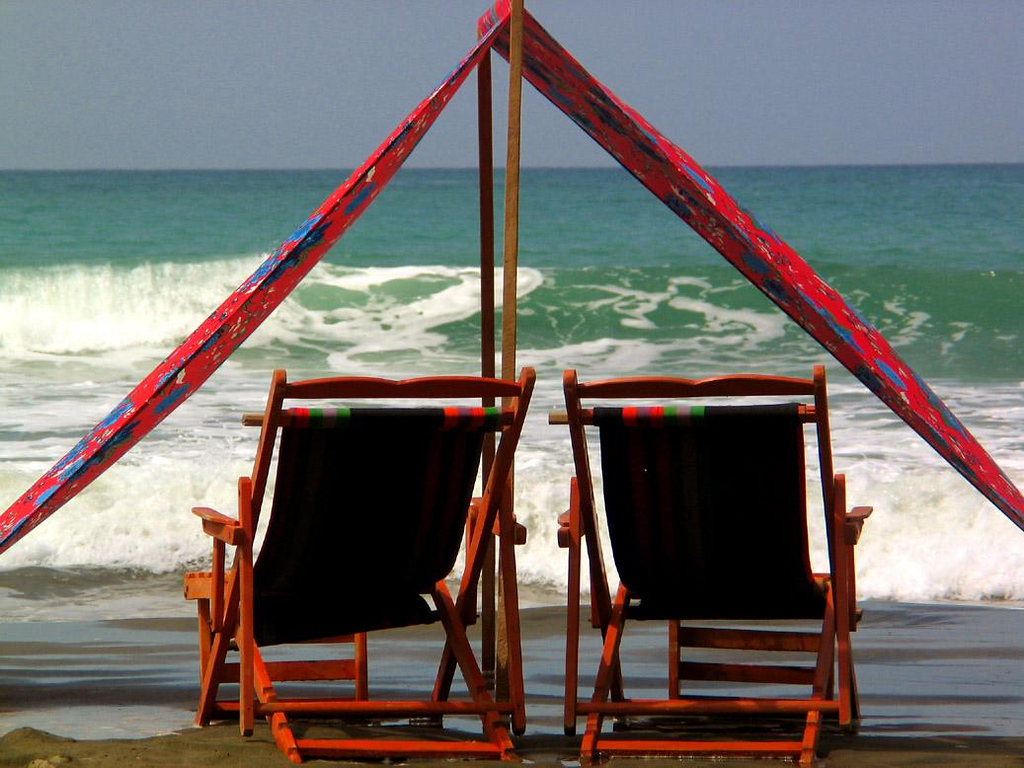 Tent for Two, Manta, Ecuador - Manta is virtually on the Equator, and the equatorial sun gets hot. Many residents enjoy the city's beautiful beaches, keeping cool under surfside tents with a great views.
