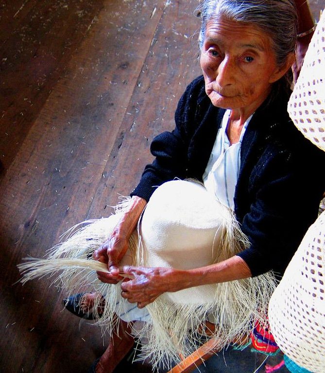 Panama Hat Maker, Montecristi, Ecuador - Hat manufacturing has long been associated with Ecuador. In fact the famous Panama Hats are made in Ecuador, not Panama. For this woman, hat-making is a way of life.