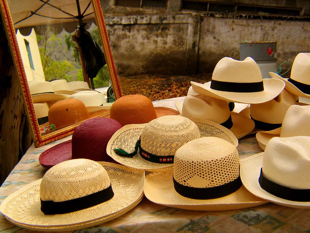 Marketplace, Montecristi, Ecuador - Panama Hats of all descriptions are sold in Montecristi's village market. They can easily be rolled up and stored.