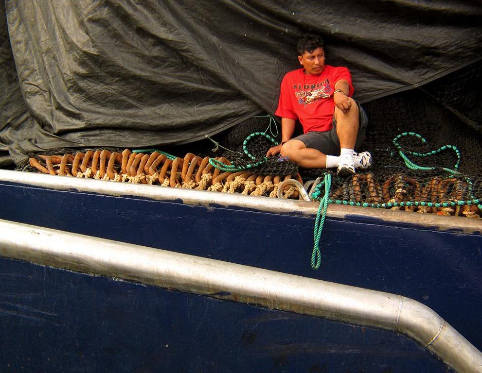 Exhausted Tuna Fisherman, Manta, Ecuador - This San Mateo fisherman can finally take things easy after long, hard day of work.