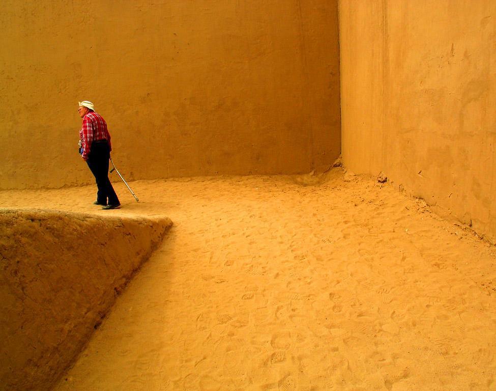 Exploring Huaca Dragon, Trujillo, Peru - A lone tourist wanders through the maze-like interior of the vast Huaca Dragon.