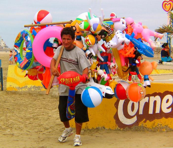 Balloonman, Manta, Ecuador - Balloons of every description are sold on the beaches of Manta.