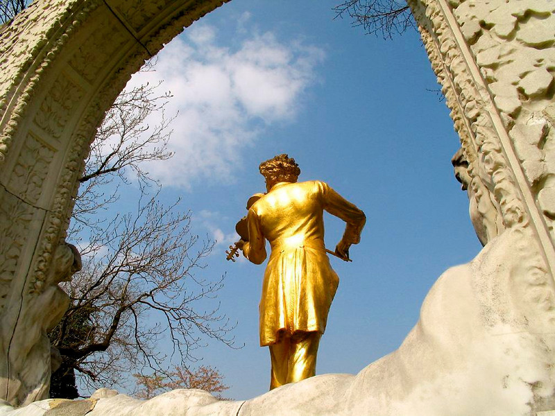 Strauss in the Stadtpark - A gilded statue of composer Johann Strauss II stands in Vienna's Stadtpark. Strauss popularized the waltz in early19th Century Vienna.