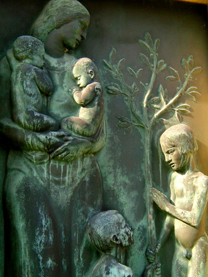 A mother's grave, Central Cemetery - Light grazes a bronze monument to a mother of four in Vienna's Central Cemetery.