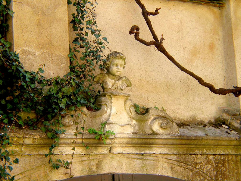 Durnstein detail - I find that small details can sometimes offer a better sense of place than pictures of buildings or entire villages. This small bust eluding the ivy over an old Durnstein doorway is just such a detail.